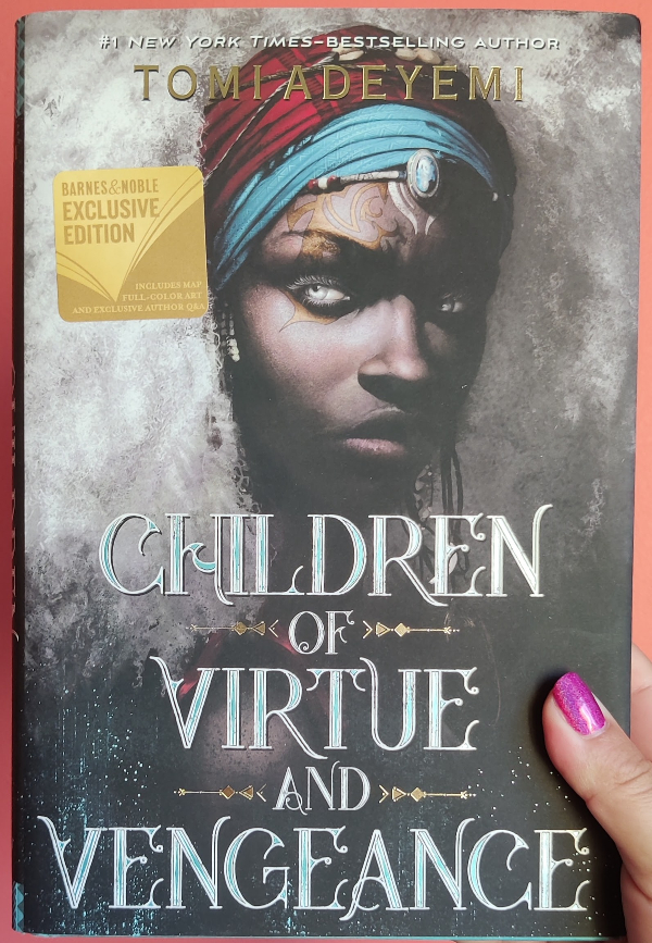 Cover of Children of Virtue and Vengeance. It features a black woman with a white afro, held back from her face by a red and blue head band adorned with conch shells and beads. She has gold scars on her face.